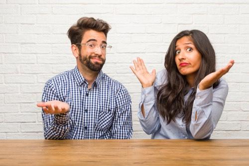 Man & Woman shrugging shoulder