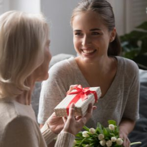 Daughter giving her mother a gift