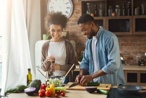Man and woman making food together