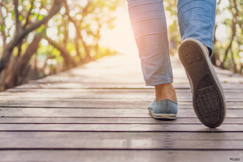 Person walking on a boardwalk